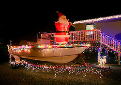 22nd December 2010. Grand Isle, Louisiana, USA. <br /> Christmas lights and decorations adorn a house.<br /> Photo; Charlie Varley