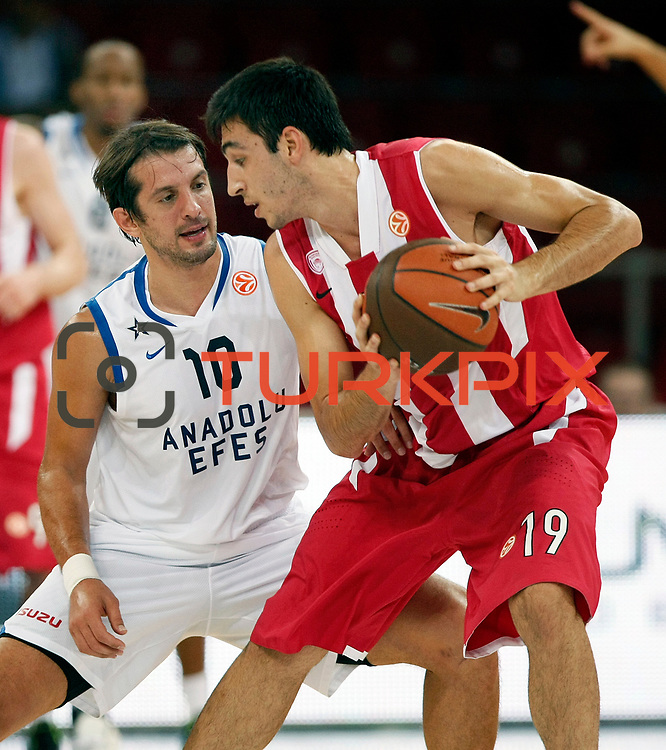 Anadolu Efes's Kerem TUNCERI (L) and Olympiacos's Dimitruios KATSIVELIS (R) during their Two Nations Cup basketball match Anadolu Efes between Olympiacos at Abdi Ipekci Arena in Istanbul Turkey on Sunday 02 October 2011. Photo by TURKPIX