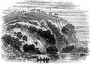 North American native burial ground, showing the dead on raised platforms. Wood engraving, 1876.