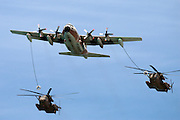 Israeli Air force Hercules C-130 transport plane refuelling two Sikorsky CH 53 helicopters in flight. During the 60th independence day parade May 8th 2008.
