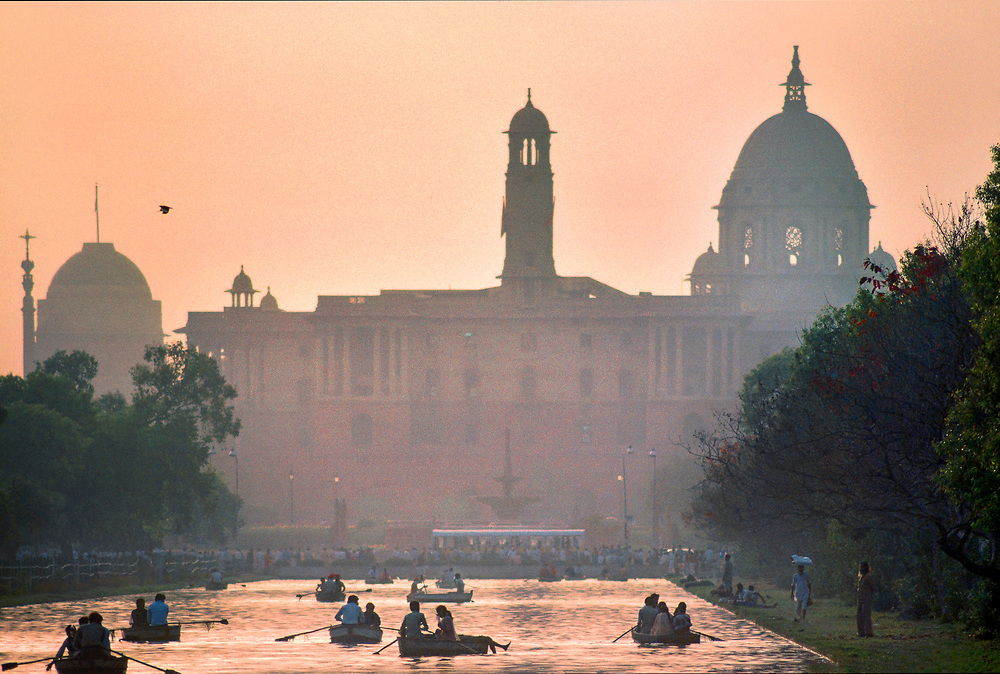 On a hazy Sunday afternoon, the Indian Secretariat, built of sandstone from Rajasthan, looms over the Rajpath — the principal ceremonial boulevard in New Delhi.   © Steve Raymer / National Geographic Creative
