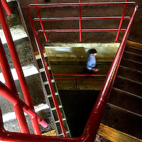 A man descends stairs in a parking garage in Philadelphia, PA September 24, 2015.