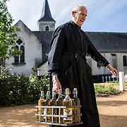 A former farmer now 87 years old, Brother Remi continues to fulfill his duties as a sacristan. He carries the mass wine here before the 10:00 a.m. service. Solesmes 07-05-16 <br /> Ancien agriculteur aujourd'hui âgé de 87 ans, le frère Remi continue de remplir son devoir de sacristain. Il transporte ici le vin de messe avant l'office de 10 h. Solesmes 07-05-16