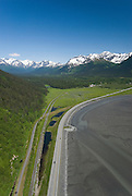 Alaska. Girdwood. Seward Highway aerial heading towards Girdwood, nestled in the Chugach Mountains.