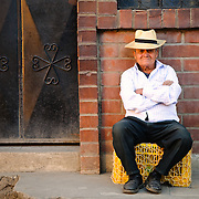 A man sits for a photo on the street in Chichicastengo, Guatemala. Chichicastenango is an indigenous Maya town in the Guatemalan highlands about 90 miles northwest of Guatemala City and at an elevation of nearly 6,500 feet. It is most famous for its markets on Sundays and Thursdays.