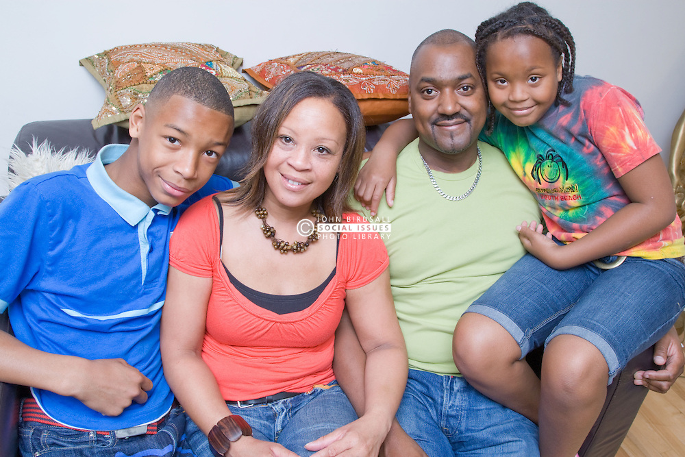 Portrait of family sitting on the sofa at home together,