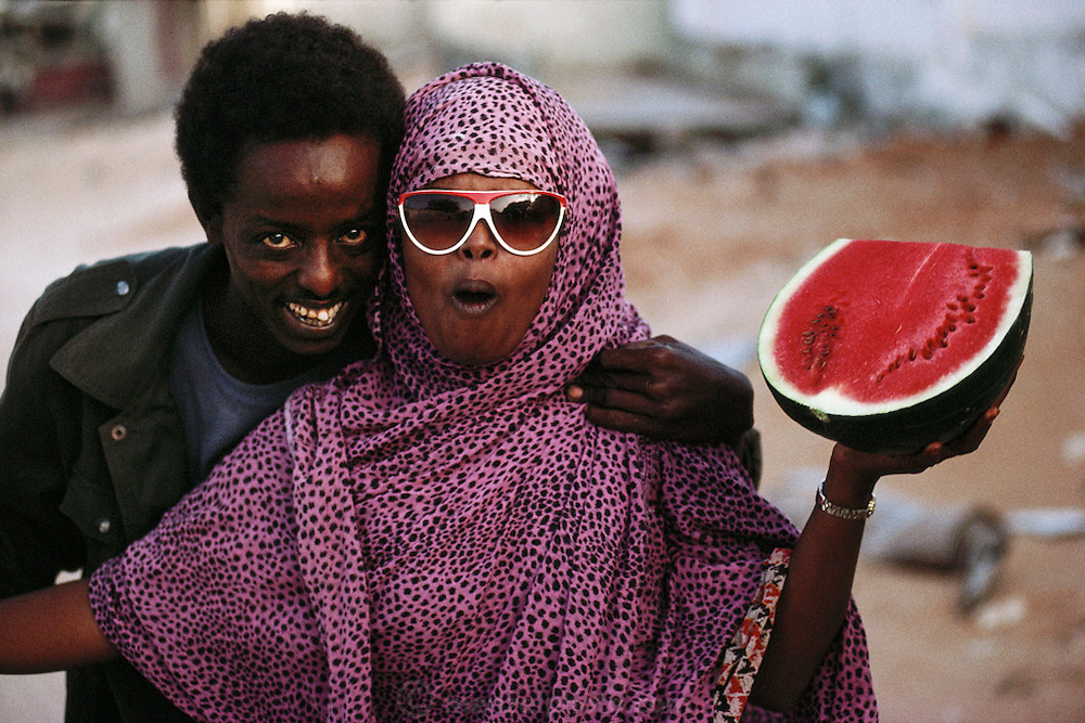 USC fighter for General Aidid with his girlfriend and a watermelon in Mogadishu, war-torn capital of Somalia. March 1992.