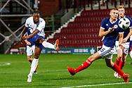 Joshua Onomah England U21s (Sheffield Wednesday, loan from Tottenham Hotspur) shoots under pressure from Ryan Porteous Scotland U21s (Hibernian FC) during the U21 UEFA EUROPEAN CHAMPIONSHIPS match Scotland vs England at Tynecastle Stadium, Edinburgh, Scotland, Tuesday 16 October 2018.