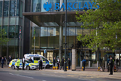 © Licensed to London News Pictures. 07/05/2020. London, UK. Police attend the scene as members of environmental protest group Extinction Rebellion protest at Barclay's in Canary Wharf in London, against the banks involvement with fossil fuels. Photo credit: Marcin Nowak/LNP