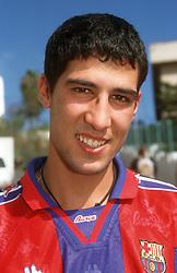 Portrait of young man wearing Barcelona football shirt,