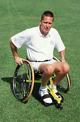 Man with disability using newly designed sports wheelchair,