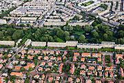 Nederland, Zuid-Holland, Den Haag, 15-07-2012; Sportlaan met flats uit de wederopbouw periode, onder in beeld de Vogelwijk. In de achtergrond de Bloemenbuurt. Aan weerszijden van de Sportlaan de 'Atlantikwall strook'. In dit gebied is tijdens de Tweede Wereldoorlog de bevolking geëvacueerd en de bebouwing ontruimd en/of gesloopt ivm aanleg tankgracht. .On both sides of the Sportlaan the Atlantic Wall strip. During the Second World War, the population of this area was evacuated and some of the buildings were demolished in order to build a antitank ditch. Post-war reconstruction appartment buildings...QQQ.luchtfoto (toeslag), aerial photo (additional fee required).foto/photo Siebe Swart