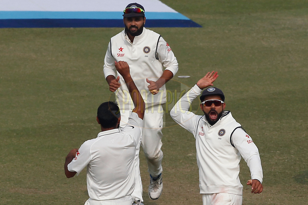 Virat Kohli Captain of India with team mates celebrates the wicket of Chris Woakes of England during day 4 of the third test match between India and England held at the Punjab Cricket Association IS Bindra Stadium, Mohali on the 29th November 2016.<br /> <br /> Photo by: Deepak Malik/ BCCI/ SPORTZPICS