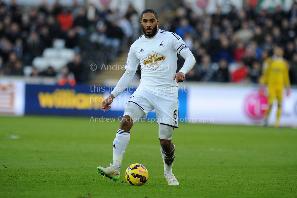 Ashley Williams of Swansea city in action.  Barclays premier league match, Swansea city v Sunderland at the Liberty stadium in Swansea, South Wales on Saturday 7th Feb 2015.<br /> pic by Andrew Orchard, Andrew Orchard sports photography.