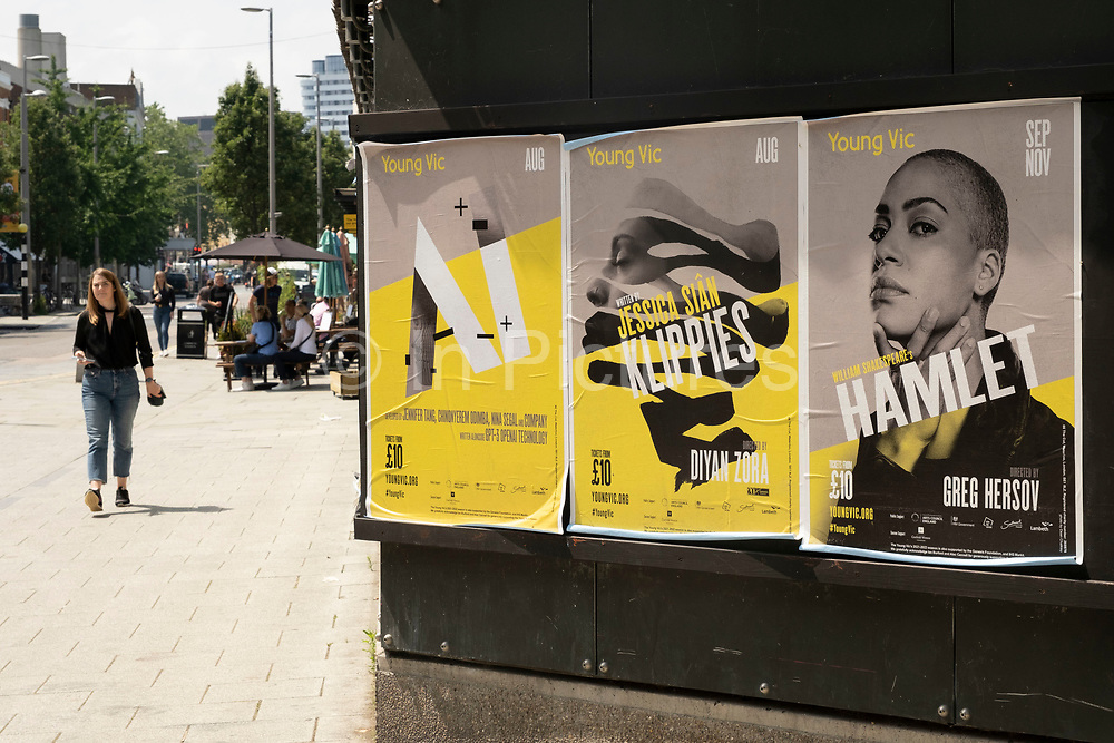 Posters for a performance of Shakespeares Hamlet at the Young Vic along The Cut on 2nd July 2021 in London, United Kingdom. The Young Vic is the younger version of the Old Vic, known for nurturing young and emerging theatre talent.