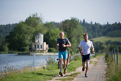 © Licensed to London News Pictures. 15/06/2021. Henley-on-Thames, UK. Two men jogging in the early morning sun, along the bank of the River Thames at Henley-on-Thames in Oxfordshire on a hot summer's morning. Photo credit: Ben Cawthra/LNP
