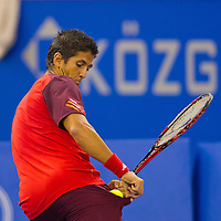 Fernando Verdasco from Spain catches a ball with his pocket during his exhibition match against Gael Monfils (not pictured) from France during the Tennis Classics tournament in Budapest, Hungary on October 29, 2011. ATTILA VOLGYI