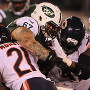 Brian Winters, New York Jets, is tackled by the Chicago Bears defense during the New York Jets Vs Chicago Bears, NFL regular season game at MetLife Stadium, East Rutherford, NJ, USA. 22nd September 2014. Photo Tim Clayton for the New York Times