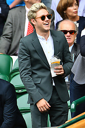 © Licensed to London News Pictures. 04/07/2016. NIALL HORAN of ONE DIRECTION watches tennis on the centre court on the seventh day of the WIMBLEDON Lawn Tennis Championships. London, UK. Photo credit: Ray Tang/LNP