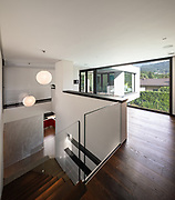 Corridor and staircase in wood with large window in modern villa. No one inside