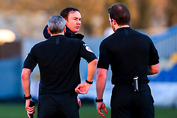 A dejected Morecambe manager Derek Adams talks with the referee and a linesman at full time - Mandatory by-line: Ryan Crockett/JMP - 27/02/2021 - FOOTBALL - One Call Stadium - Mansfield, England - Mansfield Town v Morecambe - Sky Bet League Two