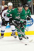 DALLAS, TX - SEPTEMBER 26:  Jamie Oleksiak #5 of the Dallas Stars controls the puck against the Colorado Avalanche in an NHL preseason game on September 26, 2013 at the American Airlines Center in Dallas, Texas.  (Photo by Cooper Neill/Getty Images) *** Local Caption *** Jamie Oleksiak