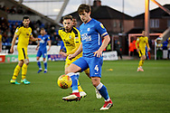 Peterborough United midfielder Alex Woodyard (4) on the ball during the EFL Sky Bet League 1 match between Peterborough United and Oxford United at London Road, Peterborough, England on 8 December 2018.