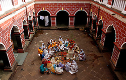 November 9, 2016 - Bhubaneswar, Orissa, India - Widows offer rituals near a Tulsi tree in the holy month √¢'ǨÀúKartik√¢'Ǩ'Ñ¢ on the start day of five days long √¢'ǨÀúPanchuka√¢'Ǩ'Ñ¢ festival at a Dharmasala (rest house for pilgrims) in Bhubaneswar on Wednesday, 09 November 2016. Widows shelter guest houses near to temple as they stay together for the rituals in this festival in every year and end their rituals after sail fancy boats in nearby water bodies along with flower, coin and earthen lamps. (Credit Image: © Str/NurPhoto via ZUMA Press)