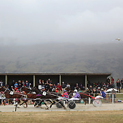 Spectators watch the harness racing during the Roxburgh Trotting Club Summer Festival Races, Roxburgh, Otago, New Zealand. 5th January 2012