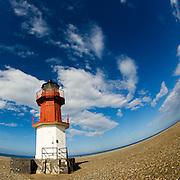Lighthouse on the shingle beach, Point of Ayre, Isle of Man.