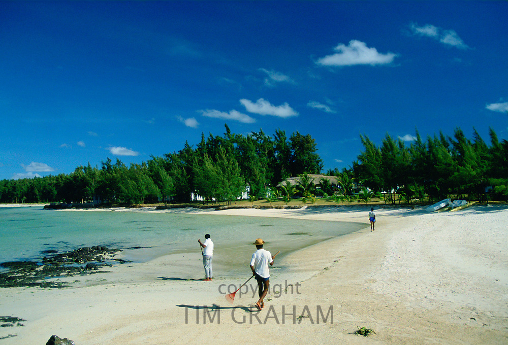 Cleaning the beach in Mauritius to aid tourism