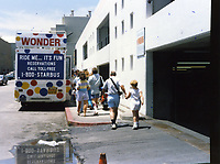 1987 Tourists embarking a Hollywood Fantasy Tours' bus
