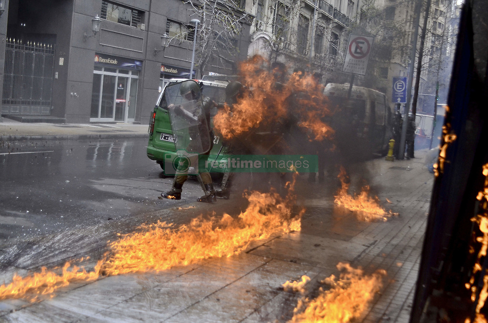 September 10, 2017 - Santiago, Santiago, Chile - Santiago Chile September 10, 2017. It commemorates the 44 years of the Military Gopel that happened in 1973. Thousands of people walked the streets of Santiago Capital of Chile. During the Commemoration there were serious incidents between the Anti-riot police and hooded. An anti-riot police group is hit by a Molotov cocktail. Santiago Chile September 10, 2017. LUISVARGAS / ZUMAPRESS  (Credit Image: © Luis Vargas via ZUMA Wire)
