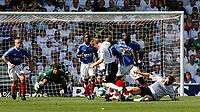 Photo: Steve Bond. <br />Derby County v Portsmouth. Barclays Premiership. 11/08/2007. Steve Howard (R), Benjani Mwaruwari (C) and Andy Todd (L) tangle