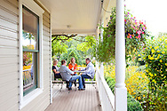 The Argyle Tasting Room in Dundee, Oregon has marvelous gardens and an outdoor porch where patrons can enjoy tasting the range of wines Argyle offers.