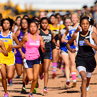 101213  Adron Gardner/Independent<br /> <br /> Navajo Pine Warrior Annoesika Laughlin, right, leads the varsity girls off the start line at the Zuni Invitational cross country meet in Zuni Saturday.  Laughlin finished second behind East Mountain Timberwolf Addison Rauch.