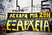 AEK Athens FC graffiti on a wall in the area of Exarhia. Exarcheia, alternatively spelled as Exarchia, Exarheia and Exarhia, is the name of a neighborhood in downtown Athens, Greece close to the historical building of the National Technical University of Athens. The Exarcheia region is famous as a stomping ground for Greek anarchists. It took the name from a merchant named Exarchos who opened a large general store there. Now this graffiti covered area is known as a home for students and members of the anarchist movement and a kind of no go area for tourists. Visitors to Athens can't help but notice the amount of graffiti in the city. Any surface that can be sprayed upon is covered with a maddening number of signatures and designs. Beautifully restored neo-classic houses from the late 19th Century usually have a few days or weeks before they are covered in graffiti and owners find themselves in a war that they eventually lose and surrender to the kids. Graffiti in Athens is as old as the city itself. In ancient times graffiti was carved into buildings, in fact the word comes from the Greek graphi which means to write. The most disturbing aspect of the graffiti besides the volume of it, is the way some of the kids whose artistic ability begins and ends with their names (tags), have defaced some of the real works of art. Athens is the capital and largest city of Greece. It dominates the Attica periphery and is one of the world's oldest cities, as its recorded history spans around 3,400 years. Classical Athens was a powerful city-state. A centre for the arts, learning and philosophy.