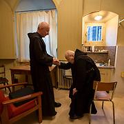 A monk helps an elderly brother to get up 10-01-16<br /> Un moine aide un frère âgé à se relever 10-01-16