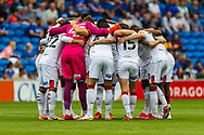 Bournemouth players huddle before the EFL Sky Bet Championship match between Cardiff City and Bournemouth at the Cardiff City Stadium, Cardiff, Wales on 18 September 2021.