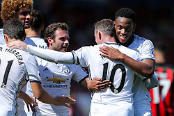 Anthony Martial of Manchester United congratulates goalscorer Wayne Rooney after he makes it 0-2 - Rogan Thomson/JMP - 14/08/2016 - FOOTBALL - Vitality Stadium - Bournemouth, England - Bournemouth v Manchester United - Premier League Opening Weekend.
