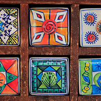 Asia, India. Painted ceramic boxes in wood frame.