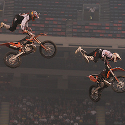 14 March 2009: The Jagermeister Freestyle team performs a double jump during a exhibition prior to the Main Event of the Monster Energy AMA Supercross race at the Louisiana Superdome in New Orleans, Louisiana