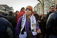 """A rally member looks on with a scarf. Rally members, remembering the death of editor-in-chief of the bilingual Turkish-Armenian newspaper Agos, Hrant Dink, wore scarves and held placards stating """"We are all Hrant, We are all Armenian""""."""