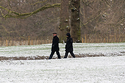 © Licensed to London News Pictures. 18/03/2018. London, UK. People walk in Green Park as snow has fallen in Central London overnight. Photo credit: Ray Tang/LNP