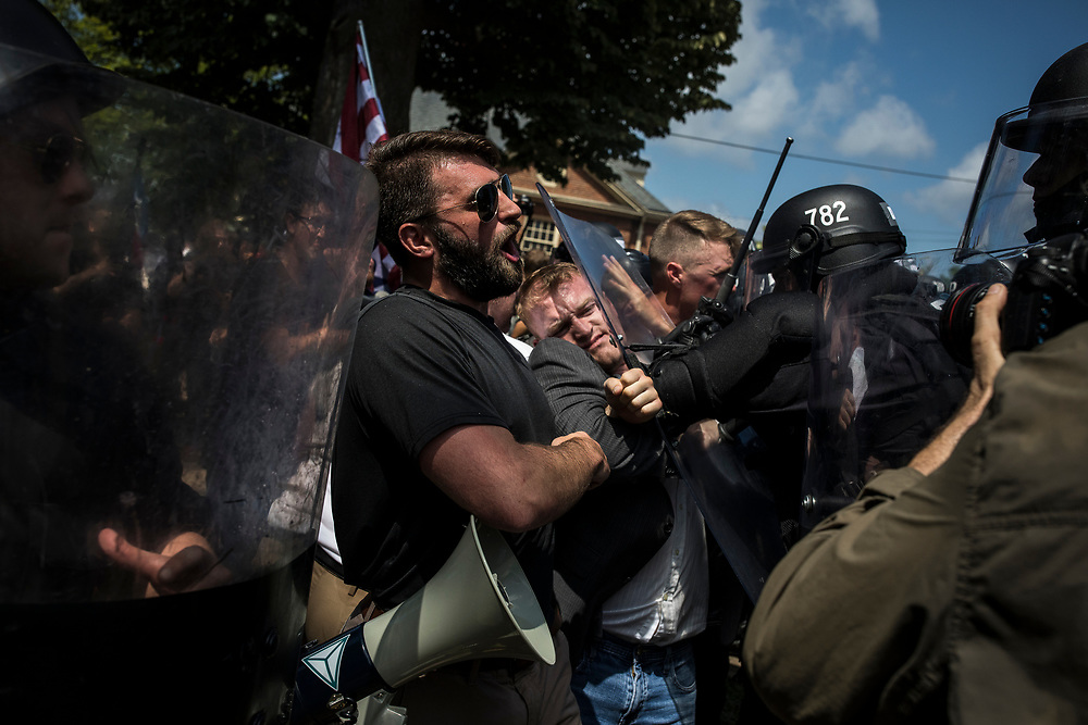 CHARLOTTESVILLE, VA. USA. August 12th 2017. White nationalists cloashing with Virginia State Police during riots in Charlottesville between Alt-Right demonstrators and counter-protesters.<br /> <br /> The rally occurred amidst the backdrop of controversy generated by the removal of Confederate monuments throughout the country in response to the Charleston church shooting in 2015. The event turned violent after protesters clashed with counter-protesters, which combined with the subsequent vehicle-ramming attack left over 30 injured