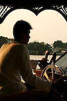 Chao Phrya River Boat Pilot - In Bangkok, the Chao Phraya is a major transportation artery for a vast network of ferries and water taxis, also known as longtails. More than 15 boat lines operate on the river and canals of the city, including commuter ferry lines.