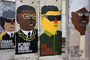 "World dictators adorn old sections of the old Berlin Wall .opposite the former Checkpoint Charlie, the former border between Communist East and West Berlin during the Cold War. The Berlin Wall was a barrier constructed by the German Democratic Republic (GDR, East Germany) starting on 13 August 1961, that completely cut off (by land) West Berlin from surrounding East Germany and from East Berlin. The Eastern Bloc claimed that the wall was erected to protect its population from fascist elements conspiring to prevent the ""will of the people"" in building a socialist state in East Germany. In practice, the Wall served to prevent the massive emigration and defection that marked Germany and the communist Eastern Bloc during the post-World War II period."