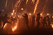 Residents scramble as they are pelted by pyrotechnic sky rockets during the Alborada festival September 29, 2018 in San Miguel de Allende, Mexico. The unusual festival celebrates the cities patron saint with a two hour-long firework battle at 4am representing the struggle between Saint Michael and Lucifer.