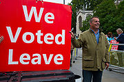 A man holds a sign with We Voted Leave on it  outside  the Houses of Parliament on 9th September 2019 in London, United Kingdom. Prime Minister Boris Johnson is tabling another motion to seek a general election.