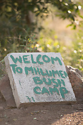 Close-up of welcome sign carved in stone, Mhlumeni Bush Camp, Eswatini